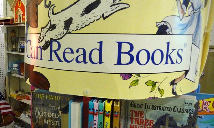 exit-76-antique-mall-i-can-read-books-sign