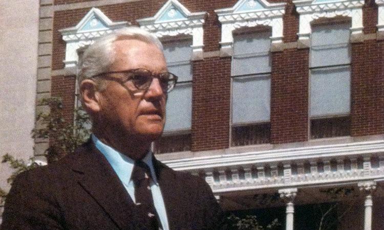 J. Irwin Miller in front of his office