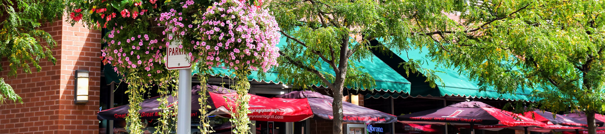 flowers and table umbrellas on fourth street, columbus, indiana