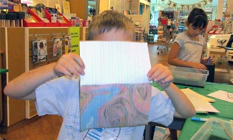boy with artwork, at U Craft Me Up