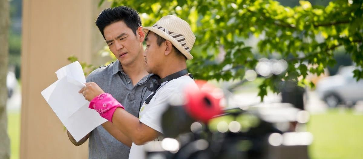John Cho discussing scene on courthouse square, Columbus - photo by Mike Wolanin, The Republic