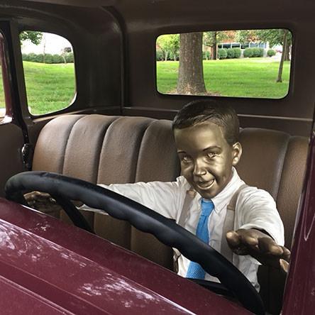 Seward sculpture, child in car